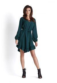 e-margeritka - Sukienka o luźnym kroju z falbaną zielona - 40. Typ kołnierza: kołnierz z falbankami. Kolor: zielony. Materiał: tkanina, poliester, materiał, elastan. Długość rękawa: długi rękaw. Sezon: jesień, zima. Typ sukienki: asymetryczne, oversize