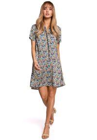 e-margeritka - Sukienka trapezowa w kwiaty z falbaną - l. Materiał: tkanina, poliester, materiał, elastan. Wzór: kwiaty. Typ sukienki: trapezowe. Styl: elegancki
