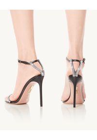 AQUAZZURA - Czarne sandały na szpilce Moon Crystal. Okazja: na co dzień. Nosek buta: okrągły. Zapięcie: pasek. Kolor: czarny. Wzór: paski, aplikacja. Obcas: na szpilce. Styl: wizytowy, klasyczny, casual. Wysokość obcasa: średni