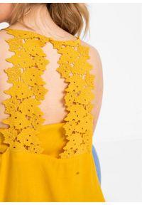 Top bonprix żółty szafranowy. Kolor: żółty