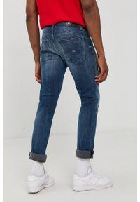 Tommy Jeans - T-shirt bawełniany. Okazja: na co dzień. Kolor: czerwony. Materiał: bawełna. Wzór: nadruk. Styl: casual