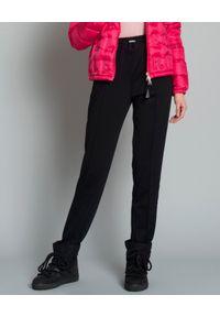 MONCLER - Spodnie dresowe czarne. Kolor: czarny. Materiał: dresówka