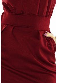 Numoco - Ołówkowa sukienka midi z zaznaczoną talią. Materiał: elastan, materiał. Typ sukienki: ołówkowe. Długość: midi