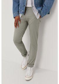 Levi's® - Levi's - Spodnie. Okazja: na spotkanie biznesowe. Kolor: zielony. Materiał: tkanina, lyocell, jedwab, materiał, bawełna. Wzór: gładki. Styl: biznesowy
