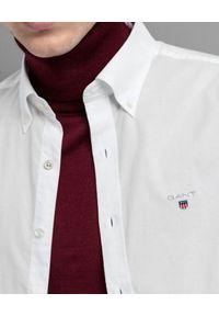 GANT - Biała koszula z szerokim kołnierzem. Kolor: biały. Materiał: jeans, bawełna. Długość rękawa: długi rękaw. Długość: długie. Styl: elegancki