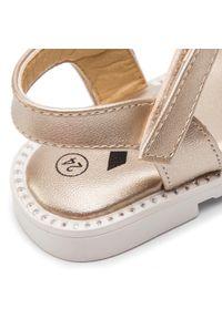 Złote sandały Xti z aplikacjami, na lato