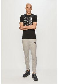 Reebok - Spodnie. Kolor: szary. Materiał: dzianina, poliester