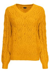Żółty sweter bonprix w ażurowe wzory