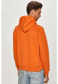 Calvin Klein Jeans - Bluza bawełniana. Okazja: na co dzień. Typ kołnierza: kaptur. Kolor: pomarańczowy. Materiał: bawełna. Styl: casual