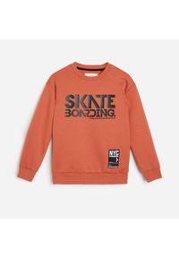 Pomarańczowa bluza Reserved z nadrukiem