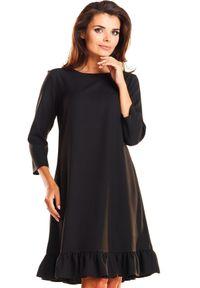 Infinite You - Elegancka trapezowa sukienka midi z krótką falbaną. Materiał: elastan. Typ sukienki: trapezowe. Styl: elegancki. Długość: midi