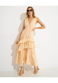 LOVE SHACK FANCY - Beżowa sukienka maxi Jordie. Kolor: beżowy. Materiał: tkanina, jedwab. Długość rękawa: na ramiączkach. Wzór: aplikacja. Typ sukienki: asymetryczne, rozkloszowane. Długość: maxi