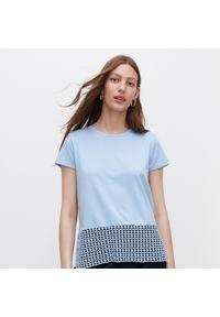 Niebieska bluzka Reserved w ażurowe wzory