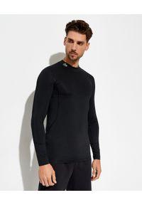 Lacoste - LACOSTE - Czarny longsleeve z tkaniny technicznej. Kolor: czarny. Materiał: tkanina. Długość rękawa: długi rękaw. Długość: długie. Wzór: aplikacja