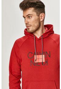 Calvin Klein - Bluza bawełniana. Okazja: na co dzień. Typ kołnierza: kaptur. Kolor: czerwony. Materiał: bawełna. Wzór: nadruk. Styl: casual