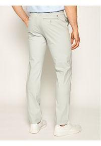 TOMMY HILFIGER - Tommy Hilfiger Tailored Spodnie materiałowe MERCEDES-BENZ Chino TT0TT07196 Szary Straight Fit. Kolor: szary. Materiał: materiał
