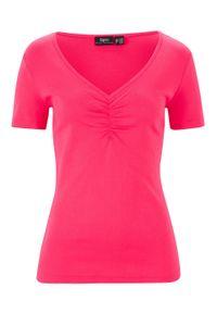 Shirt z dekoltem w serek i marszczeniem bonprix różowy hibiskus. Typ kołnierza: dekolt w serek. Kolor: różowy. Materiał: bawełna. Długość rękawa: krótki rękaw. Długość: krótkie