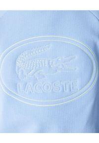 Lacoste - LACOSTE - Błękitna bluza z haftowanym logo. Kolor: niebieski. Materiał: jeans, bawełna, polar. Długość rękawa: raglanowy rękaw. Wzór: haft. Styl: sportowy