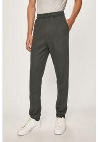 Zielone spodnie dresowe Hummel
