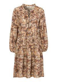 Cream Sukienka z wiskozy Augusta rdzawy we wzory female brązowy/pomarańczowy/ze wzorem 42. Typ kołnierza: dekolt w serek. Kolor: pomarańczowy, brązowy, wielokolorowy. Materiał: wiskoza. Długość rękawa: długi rękaw