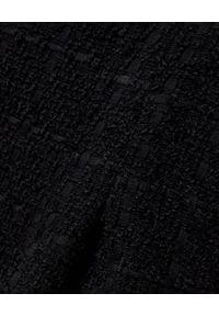 MARLU - Czarne spodnie z szerokimi nogawkami. Okazja: na spotkanie biznesowe, do pracy. Stan: podwyższony. Kolekcja: dla wysokich. Kolor: czarny. Materiał: wełna. Długość: długie. Styl: elegancki, biznesowy