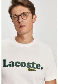 Biały t-shirt Lacoste z aplikacjami