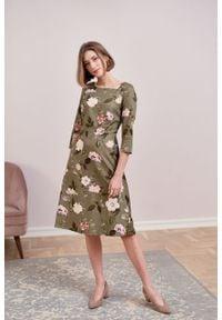 Marie Zélie - Sukienka Asteria Penumbra oliwkowa. Kolor: oliwkowy. Materiał: materiał, bawełna. Wzór: gładki. Typ sukienki: trapezowe. Styl: klasyczny