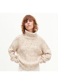 Kremowy sweter Reserved