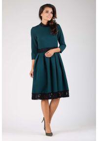 Nommo - Zielona Wizytowa Rozkloszowana Sukienka z Koronką. Kolor: zielony. Materiał: koronka. Wzór: koronka. Styl: wizytowy