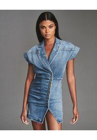RETROFETE - Jeansowa sukienka Gia. Kolor: niebieski. Materiał: jeans. Wzór: aplikacja. Typ sukienki: dopasowane. Długość: mini