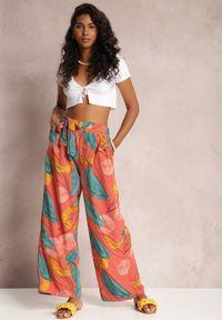 Renee - Łososiowe Spodnie Kasdasa. Stan: podwyższony. Kolor: różowy. Materiał: materiał. Długość: długie. Wzór: gładki, kolorowy