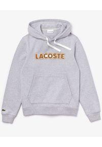 Lacoste - LACOSTE - Szara bluza z kapturem. Okazja: na co dzień. Typ kołnierza: kaptur. Kolor: szary. Materiał: jeans. Wzór: nadruk. Sezon: jesień. Styl: casual, sportowy