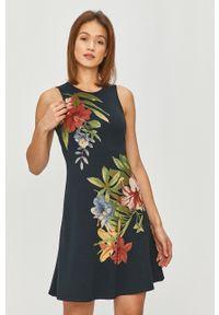 Desigual - Sukienka. Kolor: niebieski. Materiał: tkanina. Typ sukienki: rozkloszowane