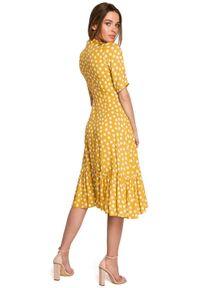Style - Sukienka midi w duże grochy z asymetryczną falbaną żółta. Kolor: żółty. Wzór: grochy. Typ sukienki: asymetryczne. Styl: retro. Długość: midi