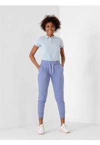 4f - Spodnie dresowe joggery ocieplane damskie. Kolor: niebieski. Materiał: dresówka