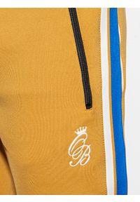 Żółte spodnie Ombre Clothing z haftami, retro