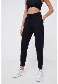 4f - 4F - Spodnie. Kolor: czarny. Materiał: dzianina, materiał