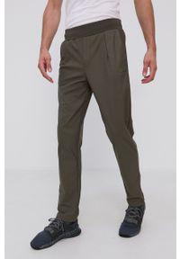Guess - Spodnie. Okazja: na co dzień. Kolor: zielony. Styl: casual