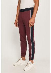 Fioletowe spodnie dresowe Armani Exchange