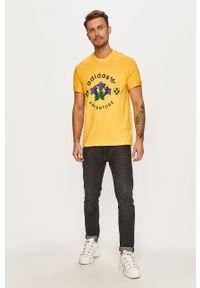 Żółty t-shirt adidas Originals z nadrukiem, na co dzień