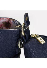 Wittchen - Torebka 2 w 1 z podszewką w kwiaty. Kolor: niebieski. Wzór: kwiaty. Materiał: skórzane. Styl: elegancki. Rodzaj torebki: na ramię