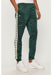 Zielone spodnie dresowe Kappa z aplikacjami