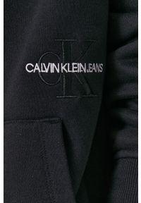 Calvin Klein Jeans - Bluza. Okazja: na co dzień. Typ kołnierza: kaptur. Kolor: czarny. Materiał: dzianina. Wzór: gładki. Styl: casual