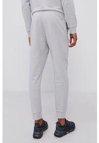 Calvin Klein Performance - Spodnie. Okazja: na co dzień. Kolor: szary. Wzór: nadruk. Styl: casual