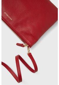 Coccinelle - Torebka skórzana Mini Bag. Kolor: czerwony. Materiał: skórzane. Rodzaj torebki: na ramię