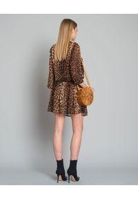 MOSCHINO - Sukienka mini z printem. Kolor: brązowy. Wzór: nadruk. Sezon: lato. Typ sukienki: rozkloszowane. Styl: elegancki. Długość: mini