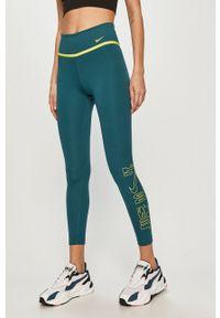 Nike - Legginsy. Kolor: zielony. Materiał: tkanina, dzianina, skóra, włókno. Technologia: Dri-Fit (Nike). Wzór: nadruk