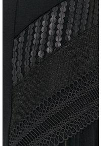 Desigual - Sukienka. Kolor: czarny. Materiał: dzianina. Wzór: gładki. Typ sukienki: rozkloszowane
