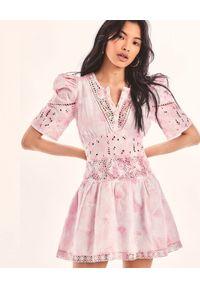 LOVE SHACK FANCY - Różowa sukienka Divine. Kolor: biały. Materiał: tkanina, koronka, bawełna. Wzór: koronka, haft, aplikacja, kwiaty. Długość: mini