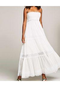 CHARO RUIZ IBIZA - Sukienka maxi Zoe. Kolor: biały. Materiał: koronka. Wzór: koronka, aplikacja. Sezon: lato. Typ sukienki: rozkloszowane, z odkrytymi ramionami. Styl: elegancki. Długość: maxi